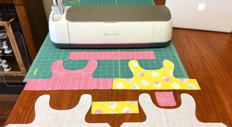Cricut Maker cutting fabric.